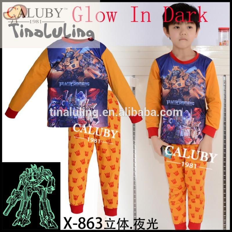 100%漫画のパジャマ綿の男の子の変圧器、 の赤ん坊の下着の子供寝間着暗闇で光る